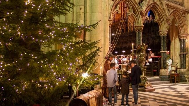 Syrian refugee lights cathedral Christmas tree during special Follow the Star service