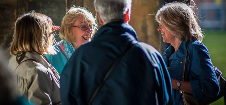 Group of people talking in the Cathedral Cloister