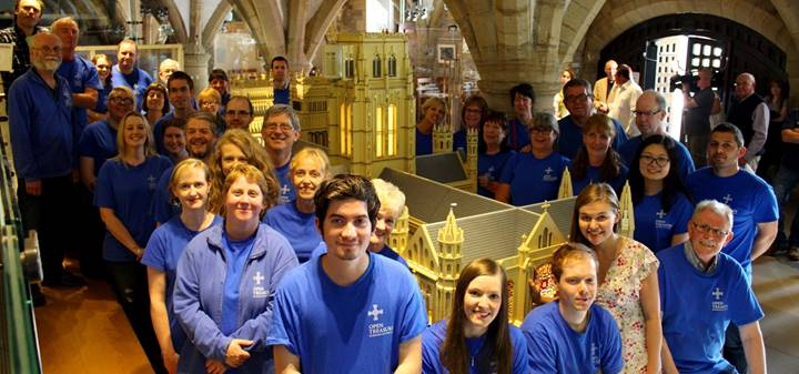 Completed LEGO model of Durham Cathedral with volunteers