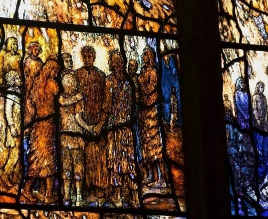 The orange tones of the Transfiguration Window