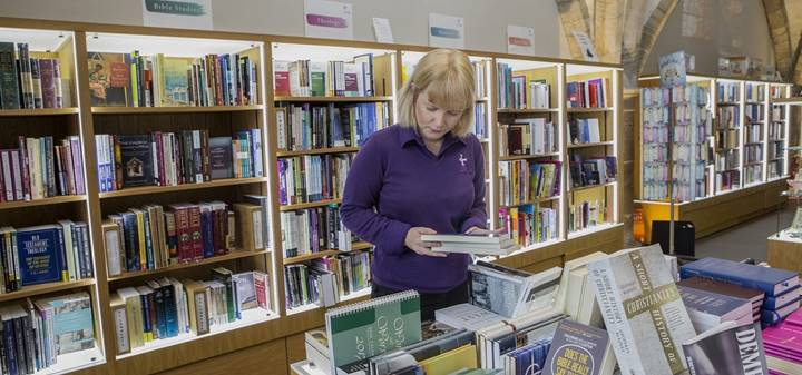 Person looking at books in the Cathedral shop