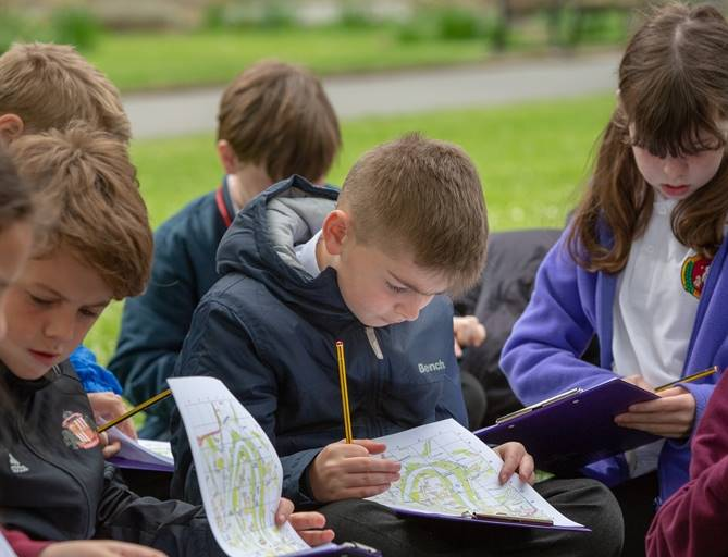Children explore the Cathedral outdoors