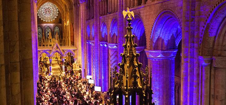 A large dining event in the nave of Durham Cathedral