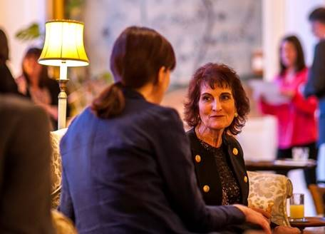 Two people talking at a Patron reception