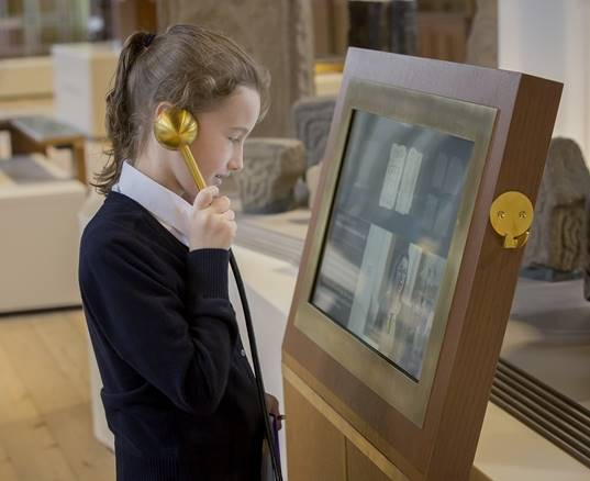 School child using interactive touchscreen in Open Treasure