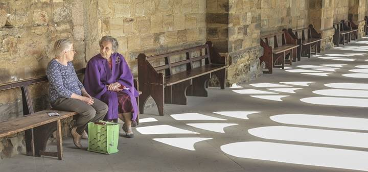 Shadows in the Cloisters with visitors