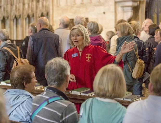 Volunteer steward leads guided tour in the Quire